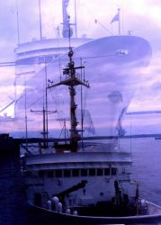 Double exposure of NOAA Ship FAIRWEATHER taken from same location at high and low tide at the pier at Anchorage Photo