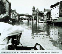 The remnants of Hurricane Camille still packed a powerful punch Traveling through the business district by boat Photo