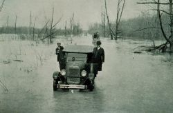The Great Mississippi River Flood of 1927 Highway between Mounds, Illinois, and Cairo Illinois, March 25, 1927 - river stage at Cairo, Illinois., 52.8 Photo