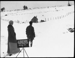 Weather Bureau observer and wife on snowshoes approaching the Weather Bureau/ Forest Service cooperative site outside of Ephriam, Utah, for snow obser Photo