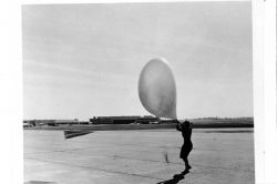 Launching a pilot balloon during strong winds at St Photo