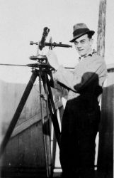 Alfred Lorenz with a theodolite for tracking weather balloons. Photo