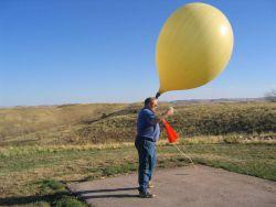 HMT Mitchell Erickson launches a weather balloon. Photo