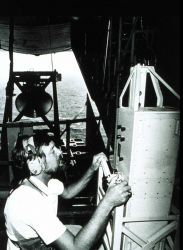 Cargo door of C-130 open while Robert Berles adjusts down-pointing laser Laser measuring wave height directly below NOAA C-130 aircraft Measurements t Photo