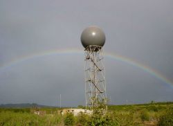 NWS Radar Tower & Radome with rainbow in the distance. Photo
