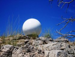 Is it a giant soccer ball? No, this is the Salt Lake City radar dome seen from a vantage point below a rock outcrop. Photo