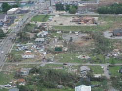 Several homes and a bank building (upper right) damaged by the Dade-Walker EF3 tornado in Trenton, Georgia. Photo