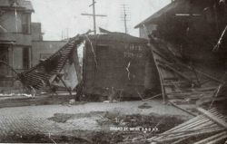 Broad Street near the B&O Railroad tracks showing box car on side with torn up track. Photo