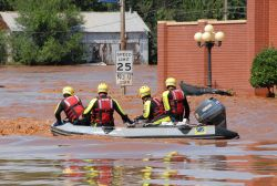 Rescue team in flooded neighborhood. Photo