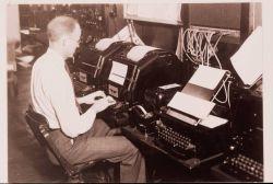 Using a teletypewriter to transmit weather information Photo