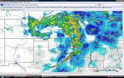 Classic comma-shaped system with tornadoes forming ESE of low-pressure center which is over western Kansas Photo