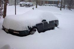 Automobile being covered by snow - Photo -1. Photo