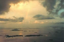 A rainbow makes a bright spot in the water Image