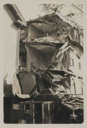 A falling chimney weakened and helped destroy much of the wall of this residence on West Friendship Street Image