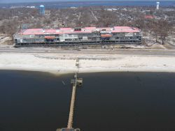 Largest of two barges from Biloxi Grand Hotel aground across Highway 90. Photo