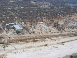 Debris from port facility strewn throughout Gulfport. Photo
