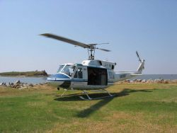 NOAA Helicopter 61 conducting post-Katrina inspections and studies. Photo