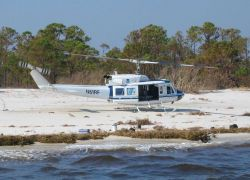 Beach landing to inspect tide station. Photo