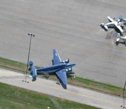 Aircraft blown around with one flipped over at Lakefront Airport. Image
