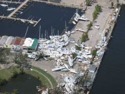 Boats tossed around like kindling at a marina. Photo