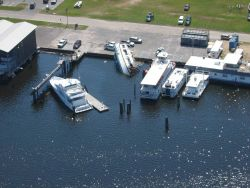 A curious effect of Hurricane Katrina left one boat on the pier while others appear to have escaped relatively unscathed. Image