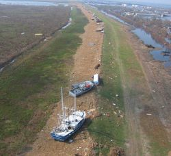 Shrimp boats, barges, and debris on the bank at Venice after Hurricane Katrina. Photo