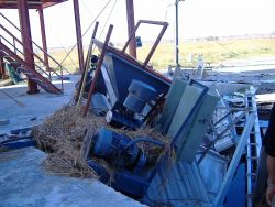 A jumbled heap of motors, compressors and other equipment at the ice plant. Image