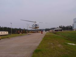 NOAA helicopter taking off from the temporary base at the National Data Buoy Center Photo
