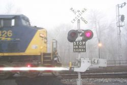 A fast freight slicing through the fog at Brunswick, MD. Image