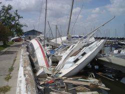 Sailboats wrecked by Hurricane Katrina. Photo