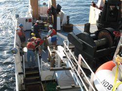 Anchor line streaming aft as the NOAA Ship GORDON GUNTER steams slowly head leaving the TAO buoy astern Image