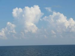 While the TAO buoy streams aft, innocent looking clouds approach Photo