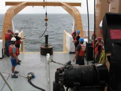 Following passage of the waterspout, the crew prepares to drop the anchor for the TAO buoy Photo