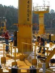 Field Technicians preparing 10-Meter Buoy for deployment. Photo