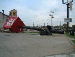 A Jack in the Box sign crushed a vehicle during Hurricane Rita. Image