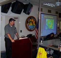Meteorologist Daniel Noah, NWS Tampa Bay Area, provides a weather briefing to the Lee County Emergency Operations Center just before Hurricane Wilma m Photo