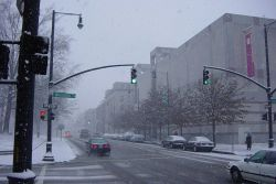 Several state museums are visible in this image of Edenton Street in downtown Raleigh during a January snow in North Carolina. Photo