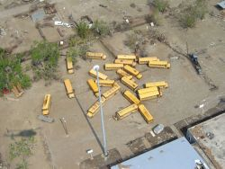 School buses along the Mississippi River re-positioned by Hurricane Katrina. Photo