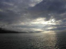 An array of clouds, fog, and sunshine on the Alaska Peninsula Image