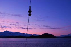 Setting sun in Glacier Bay Photo