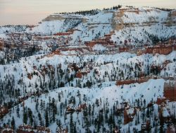 Snow and red rock formations at Bryce Canyon National Park Photo