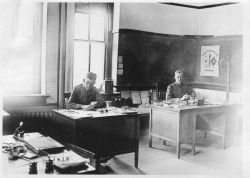 Johnson, rank uncertain, on left and Lieutenant Hovde on right at meteorological school. Photo