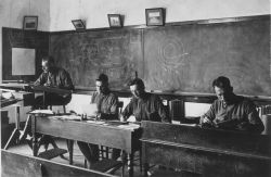 Signal Corps meteorological students working on records and computations in Record Room. Photo