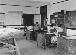 Signal Corps meteorological students working in the reference section. Photo