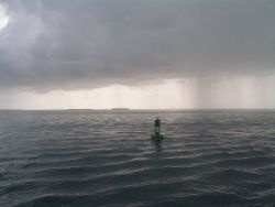 Rain squalls in the area as the NOAA Ship PISCES departs Key West. Photo