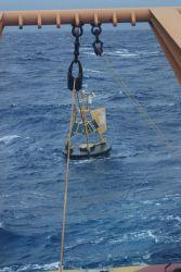 Recovering an adrift 3-meter weather buoy off the NOAA Ship Ka'imimoana Photo