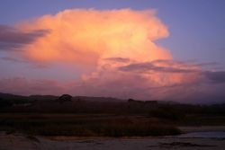 A thunderstorm seen from the mouth of Carmel River looking SE over the coast range of mountains. Photo