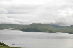 Clouds lying over mountains at Dutch Harbor. Photo