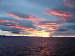 Sunset over Alaska Peninsula. Photo