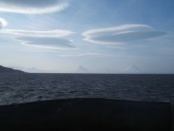 Wave clouds over the Islands of the Four Mountains. Photo